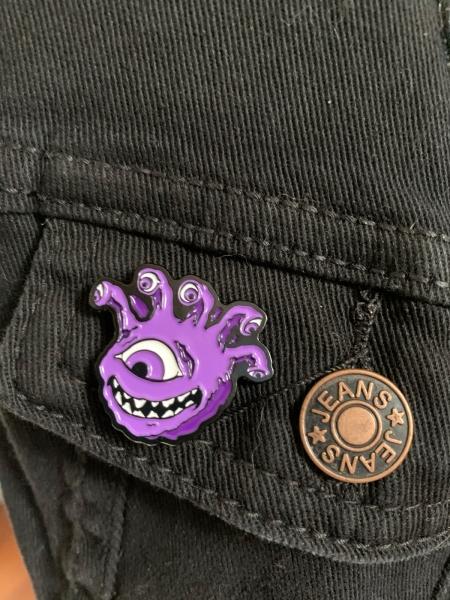 Purple Eyegor Enamel Pin on Jacket