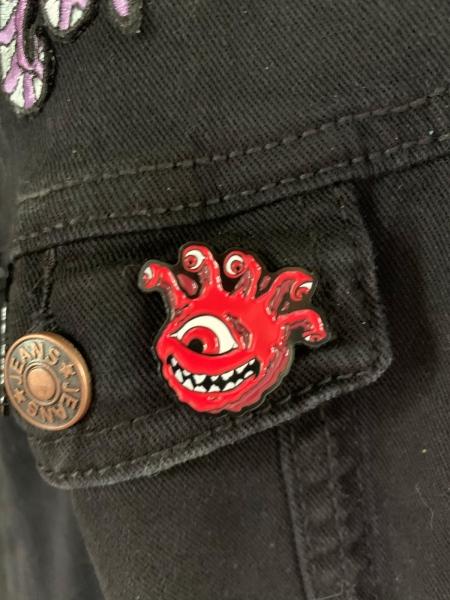 Cherry Red Eyegor Enamel Pin on Jacket